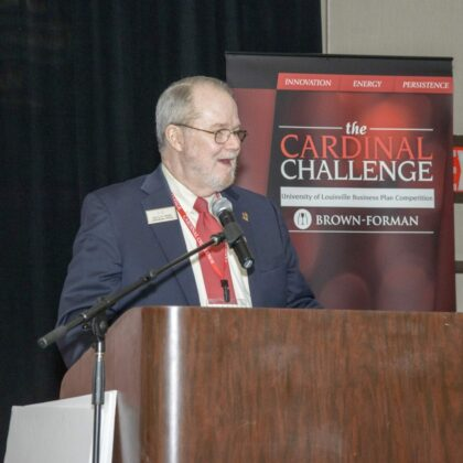 Dr. Van G. H. Clouse speaking at Cardinal Challenge podium