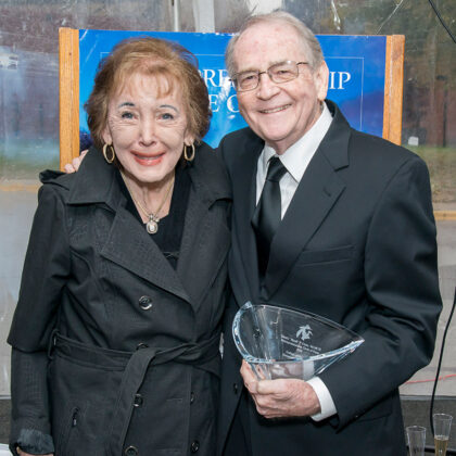 Hank Conn and wife accepting award and joining College of Business Circle of Fame 2018