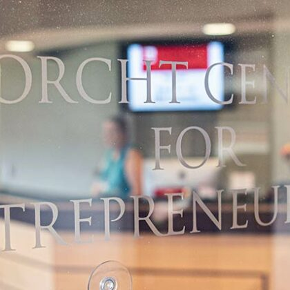 Close-up of Forcht Center For Entrepeneurship sign laser-etched into lobby window