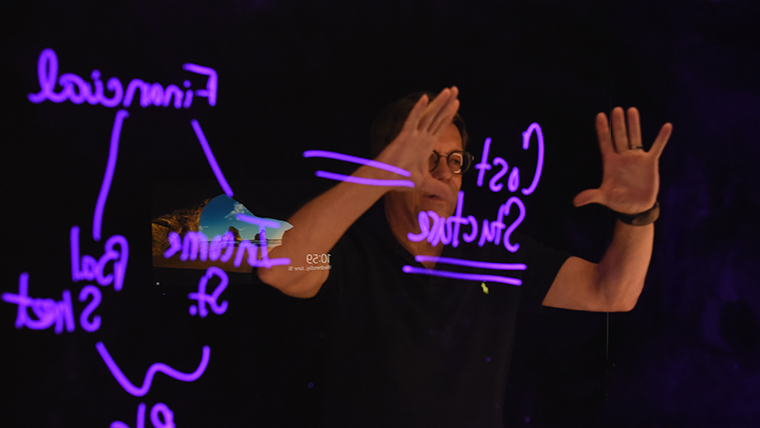 IT Director John Merchant demonstrating the Lightboard.